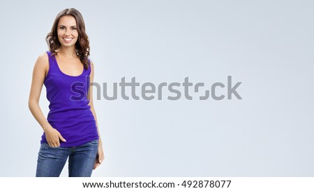 Portrait of young smiling woman. Blank copyspace area for advertising slogan or text message. Caucasian brunette model in emoshions and optimistic, positive, happy feeling concept studio shoot.