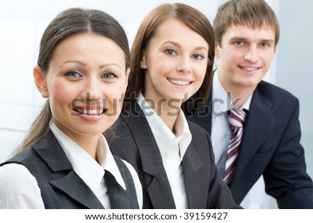 Portrait of young successful professionals looking at camera