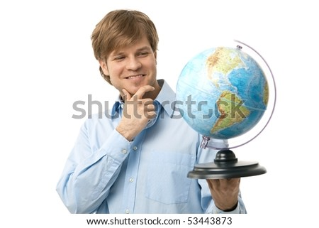 Portrait of young traveler, holding globe in hand, thinking on his next destination. Isolated on white.