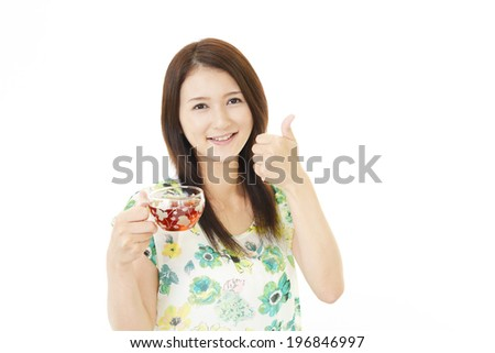 Portrait of young woman drinking tea.