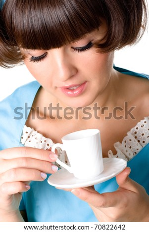 portrait of young woman enjoying a cup of coffee on white background