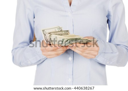portrait of young woman holding and counts money dollar bills in hands, isolated on white background. lending and banking services or financial reward savings