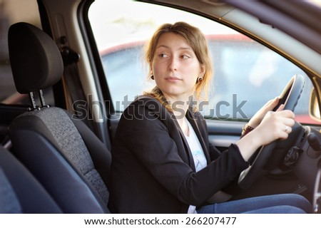 Portrait of young woman in a car