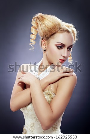 Portrait of young woman with perfect make-up and cute hair style like a doll