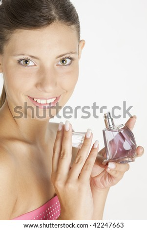 portrait of young woman with perfume