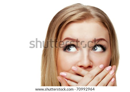 portrait shot of a beautiful caucasian woman. Holding her face in astonishment.