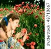 Portrait teen girl with poppy on nature - stock photo