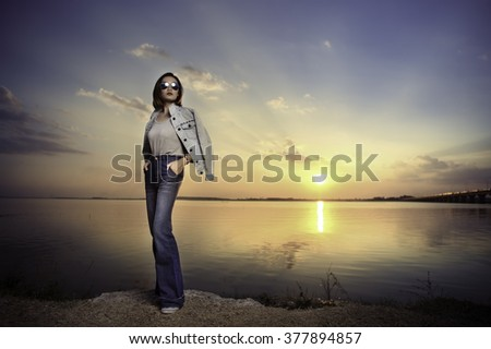 Portrait woman on the field with beautiful sunset.