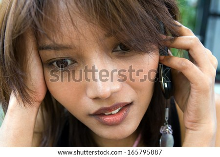 Portrait woman with cellular telephone
