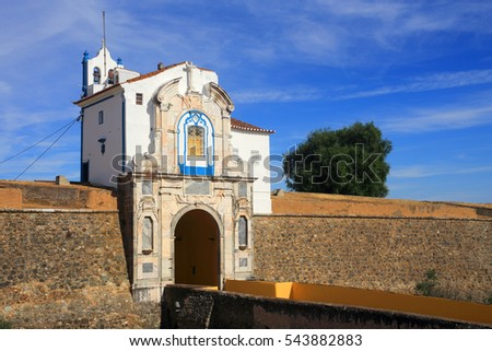 Portugal, Alentejo region, Elvas. An ornate city gate and chapel in the ancient fortified city wall. The Garrison Border Town of Elvas and its Fortifications is a UNESCO World Heritage site.