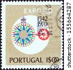 """PORTUGAL - CIRCA 1970: A stamp printed in Portugal from the """"Expo 70"""" issue shows a compass, circa 1970.  - stock photo"""