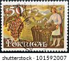 PORTUGAL - CIRCA 1970: A stamp printed in Portugal shows woman picking grapes for Porto wine, circa 1970 - stock photo