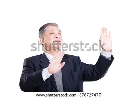 pose and gesture of old Asian businessman in black suit against white