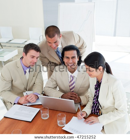 Positive business team working at a computer in a office