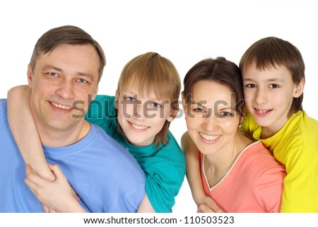 Positive family having fun in bright T-shirt on a white background