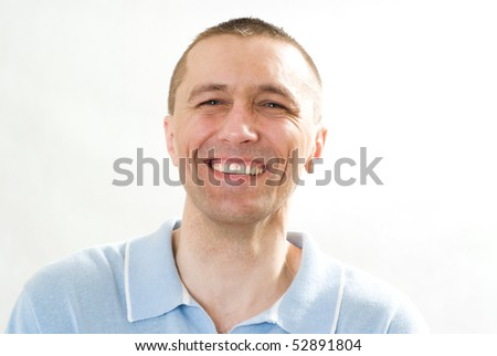 positive man in a blue shirt on a white