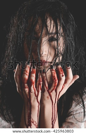 Possessed Woman with bloody hands