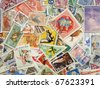 Postage stamps of different countries and times. Background. - stock photo