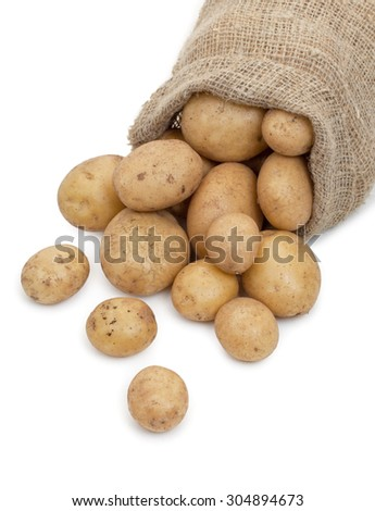 Potato tubers in a sack isolated on white