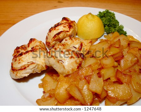 Potato with slices of chicken meat