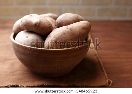 Potatoes in rustic wooden bowl