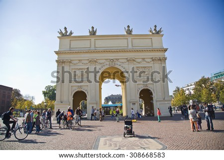 POTSDAM-GERMANY - OCTOBER 03,people cross the Luise square and Brandenburg Gate in Potsdam on October 03,2014.