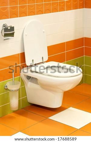 Potty seat in vivid orange and green toilet
