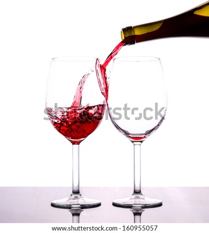 pouring red wine isolated on white