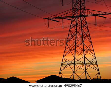 Power line at orange sunset