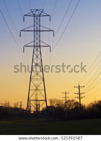 Power lines with sunset in background