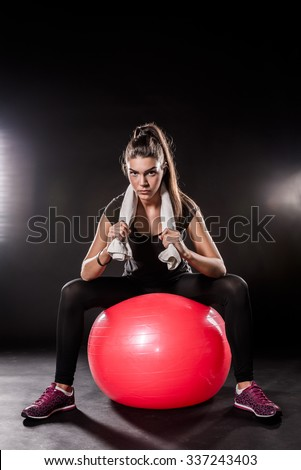 Powerful Fitness Girl On Red Fitness Ball