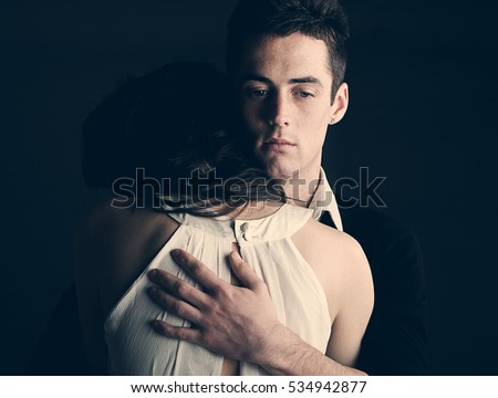 Powerful shot of a young couple embracing