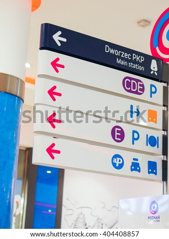 POZNAN, POLAND - JANUARY 19, 2014: Signs showing direction to important places in the Poznan City Center shopping mall
