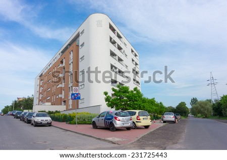 POZNAN, POLAND - JUNE 11, 2014: Apartment building with parked cars