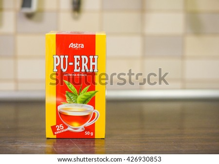 POZNAN, POLAND - FEBRUARY 24, 2017: Tymbark apple juice in a large box on wooden table in soft focus