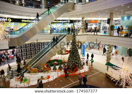 POZNAN, POLAND - NOVEMBER 29, 2013: People walking in the decorated shopping mall Malta