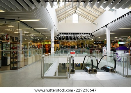 POZNAN, POLAND - OCTOBER 26, 2013: Stores and shops in the Pasaz Rondo shopping mall