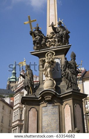 Prague - baroque column of Holy Trinity and tower of st. Vitus cathedral
