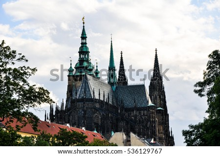 PRAGUE , CZECH REPUBLIC - July 18, 2015 : Top of gothic architecture of St. Vitus cathedral. Famous Castle in Prague, Praha Czech Republic.