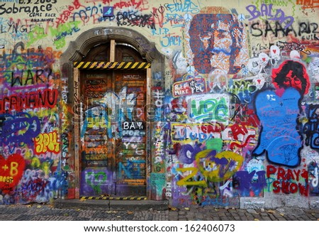 PRAGUE, CZECH REPUBLIC - NOVEMBER 05:The Lennon Wall since the 1980s filled with John Lennon-inspired graffiti and pieces of lyrics from Beatles songs on Nov 05, 2013 in Prague, Czech Republic