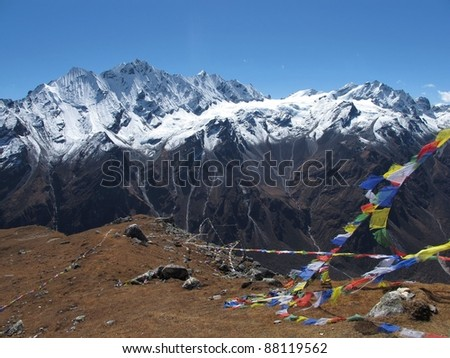 Prayer flags on a mountain-peak in the Langtang-valley, Nepal. At 4984 m. altitude.