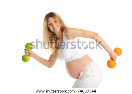 Pregnant woman involved in fitness dumbbells made from apples and oranges