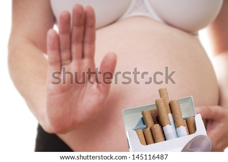 pregnant woman rejects cigarette / rejects cigarette