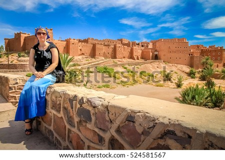 Pregnant woman tourist in front of Kasbah in Ouarzazate, Morocco