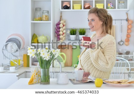 pregnant woman with tea and magazine
