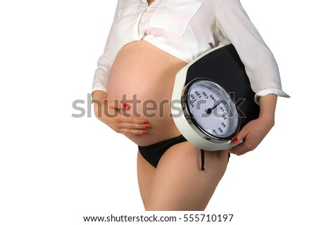 Pregnant woman with weighing machine