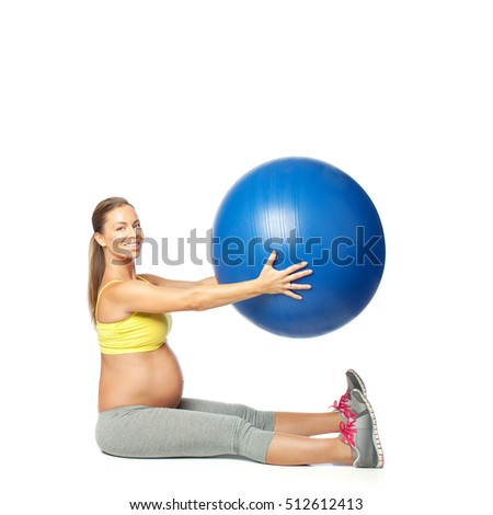 Pregnant woman working out with exercise ball, isolated on white
