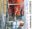 Preparation Peking Roast Duck at the restaurant, square image - stock photo