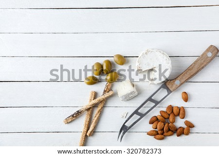 Preparing Tasty Snack With Goat Cheese And Almond