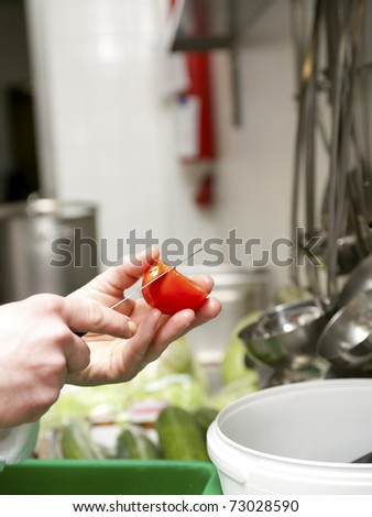 Preparing tomato for salad in a commercial kitchen